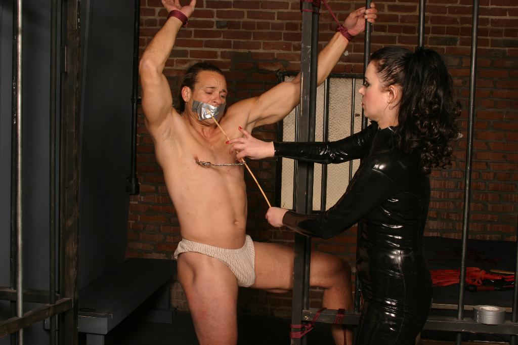 Domme Punishes Slave With Spanking